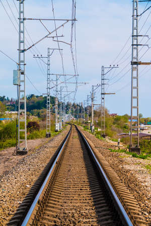 Vertical view of the railroad going into the distance in sunny day, Sochi, Russia Stock Photo