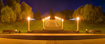 Panoramic view of Zavokzalnyy Memorial Complex with stairs and luminous lampposts at dusk, Sochi, Russia