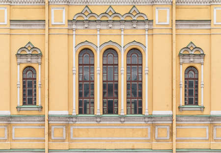 Several windows in a row on facade of the Church of Saint Isidore front view, St. Petersburg, Russia Stock Photo