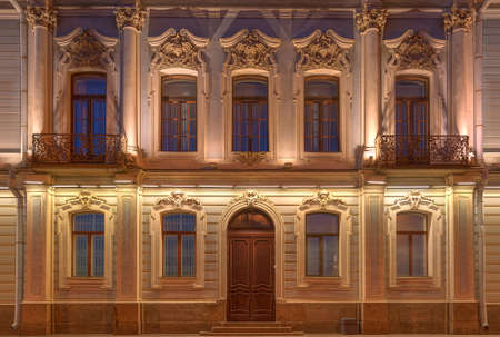 pilaster: Several windows two balconies in a row and door on night illuminated facade & Pilaster Stock Photos \u0026 Pictures. Royalty Free Pilaster Images And ... Pezcame.Com