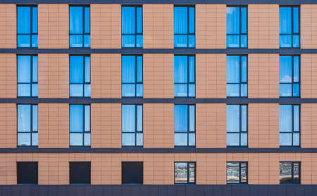 Many windows in a row on facade of modern urban building front view, St. Petersburg, Russia