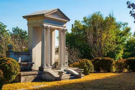 The monument in the form of a portico on the Oakland Cemetery in sunny autumn day, Atlanta, USA Stock Photo