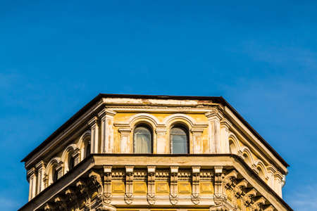 Low angle view of the attic of the urban historic building on the background of clear sky, Saint Petersburg, Russia Stock Photo