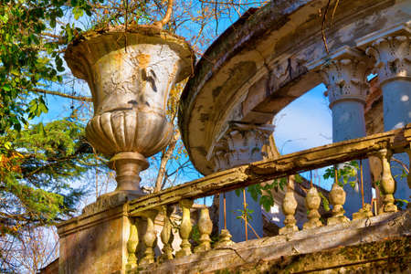 Vase, balustrade and rotunda of the abandoned building of the former restaurant on the top of Mount Akhun in sunny autumn day, Sochi, Russia
