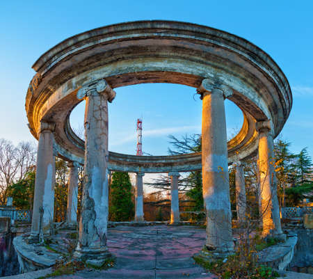 Rotunda of the abandoned building of the former restaurant on the top of Mount Akhun in sunny autumn day, Sochi, Russia