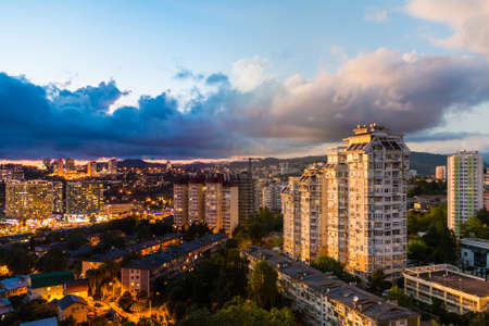 Time-lapse collage of day to night transition. Aerial view of the apartment district of the city of Sochi, Russia