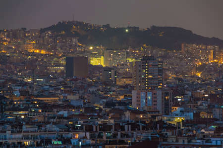 Aerial view of the illuminated Barcelona city at twilight, Spain