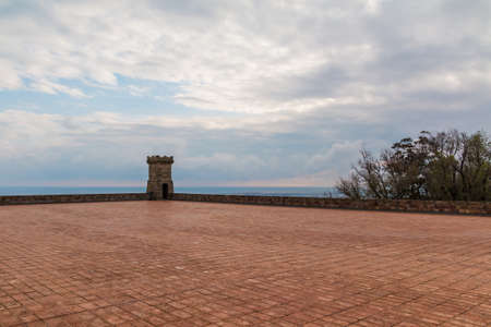 Barcelona, Catalonia, Spain - November 16, 2018: The tower and the upper area of the Montjuic Castle with pavement in cloudy day Redakční