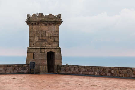 Barcelona, Catalonia, Spain - November 16, 2018: The tower of the Montjuic Castle on the upper area closeup in cloudy day Redakční