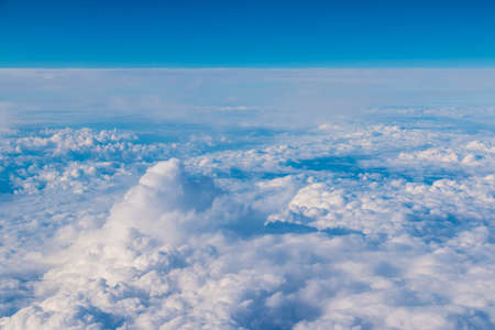 View from the porthole of airplane of a beautiful cloudscape of stratocumulus clouds Stock fotó