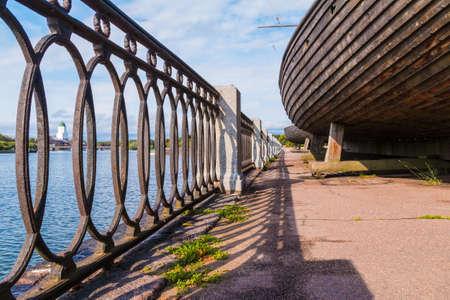 Low-angle view of the fence of the embankment of Salakkalahti Bay and hulls of Viking ships, Vyborg, Leningrad Oblast, Russia