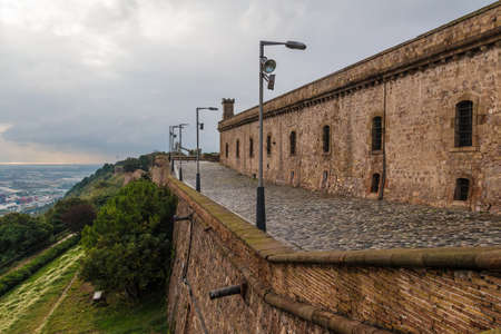 Barcelona, Spain - November 16, 2018: Perspective view of the pavement and fortress of the Montjuic Castle in overcast day