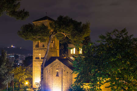 Barcelona, Catalonia, Spain - November 17, 2018: Beautiful night view of the illuminated Romanesque Chapel in the open-air Poble Espanyol architectural museum