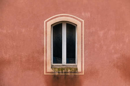 Barcelona, Catalonia, Spain - November 18, 2018: A window on the facade of historic building of the Baldiri Reixac School in the Park Guell closeup front view Editorial