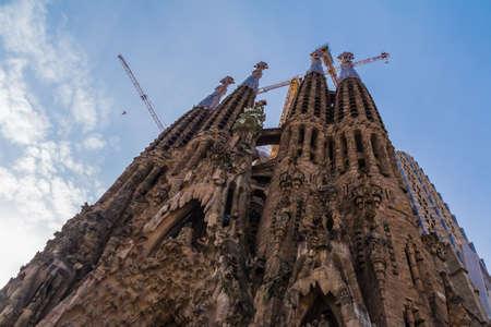 Barcelona, Catalonia, Spain - November 19, 2018: Worm's-eye view of the Temple Expiatori de la Sagrada Familia (Expiatory Church of the Holy Family) in clear day Editorial