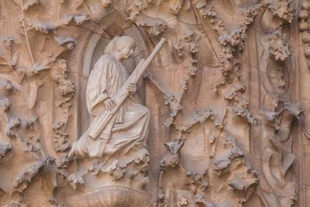 Barcelona, Catalonia, Spain - November 19, 2018: The sculpture on the facade of the Temple Expiatori de la Sagrada Familia (Expiatory Church of the Holy Family) closeup