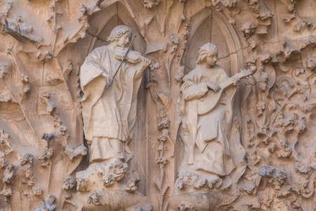 Barcelona, Catalonia, Spain - November 19, 2018: The sculptures on the facade of the Temple Expiatori de la Sagrada Familia (Expiatory Church of the Holy Family) closeup