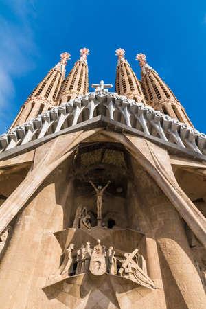 Barcelona, Catalonia, Spain - November 19, 2018: Worm's-eye view of the Temple Expiatori de la Sagrada Familia (Expiatory Church of the Holy Family) in sunny day