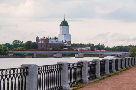 Embankment of Salakkalahti Bay on the background of the Vyborg Castle and the Petrovsky Bridge in overcast day, Vyborg, Leningrad Oblast, Russia