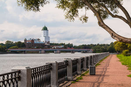 Embankment of Salakkalahti Bay on the background of the Vyborg Castle and the Petrovsky Bridge in cloudy day, Vyborg, Leningrad Oblast, Russia