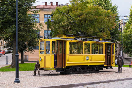 Vyborg, Leningrad Oblast, Russia - September 12, 2018: Tram Cafe on Bankovskiy Proyezd on the background of apartment building in overcast day Editorial