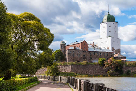 Beautiful view of the Embankment of 30th Guards Corps and the Vyborg Castle in sunlight, Vyborg, Leningrad Oblast, Russia Banco de Imagens