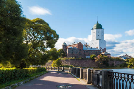 Beautiful long-exposure view of the Embankment of 30th Guards Corps and the Vyborg Castle in sunlight, Vyborg, Leningrad Oblast, Russia Banco de Imagens