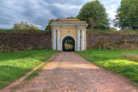 Fredrikshamn Gate between two stone walls in overcast day in HDR processing, Annenkrone, Vyborg, Leningrad Oblast, Russia