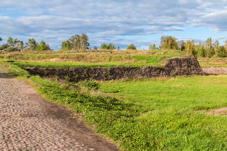 Stone walls and moats covered by the grass in Annenkrone in sunny day, Vyborg, Leningrad Oblast, Russia
