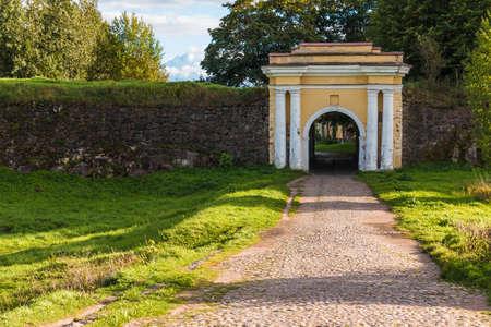 Fredrikshamn Gate between two stone walls in sunny day, Annenkrone, Vyborg, Leningrad Oblast, Russia