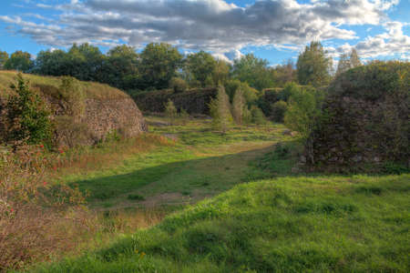 Stone walls and moats covered by the grass in Annenkrone in sunny day in HDR processing, Vyborg, Leningrad Oblast, Russia Banco de Imagens