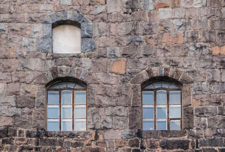 Several windows in the stone wall of the Vyborg Castle front view, Vyborg, Leningrad Oblast, Russia Banco de Imagens