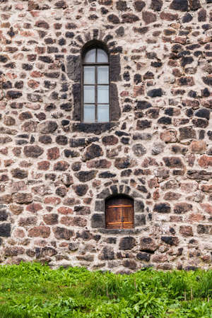 Two windows in the stone wall of the Vyborg Castle front view, Vyborg, Leningrad Oblast, Russia Banco de Imagens