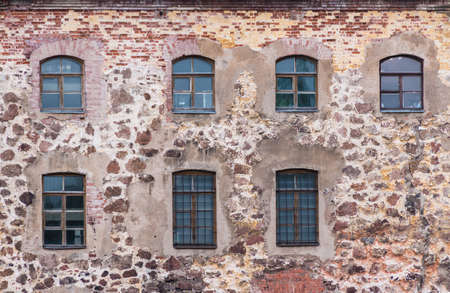 Several windows in a row in the stone wall of the Vyborg Castle front view, Vyborg, Leningrad Oblast, Russia Banco de Imagens