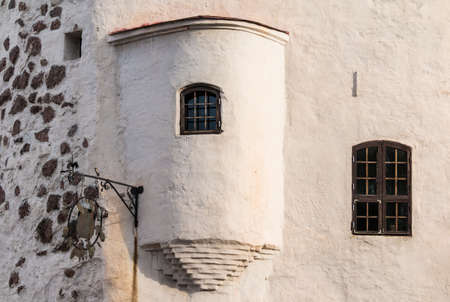 Bow window and windows on the facade of the Round Tower, Vyborg, Leningrad Oblast, Russia Banco de Imagens