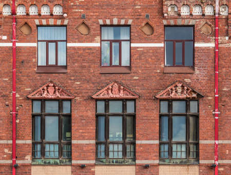 Several windows in a row on the facade of the urban historic building front view, Vyborg, Leningrad Oblast, Russia