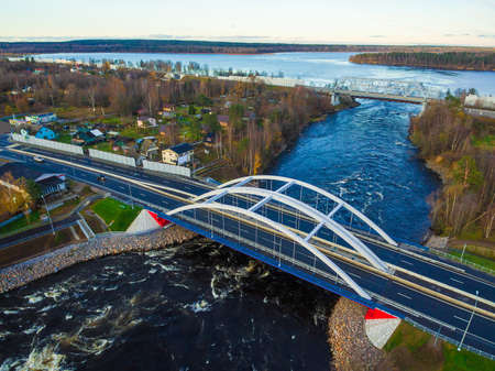 Drone view of the Vuoksi River Bridge and the settlement in autumn day, Losevo, Leningrad Oblast, Russia
