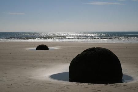new zealand beach: New Zealand s Moeraki Boulders Stock Photo