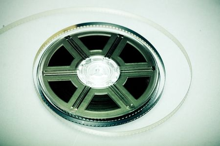 screenplay: Film reel - concept background. Movie industry symbol.