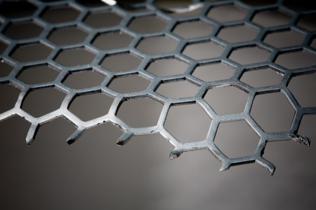 isoalated: Abstract Background of metal hex grid pattern and part missing