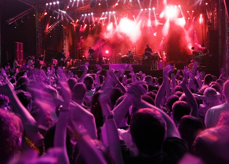 stage performer: Band at rock music concert. Blur crowd motion