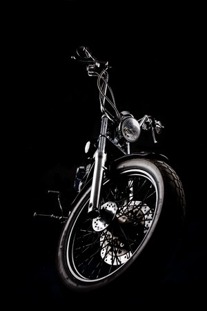 moto: Chopper motorcycle front isolated on black Stock Photo