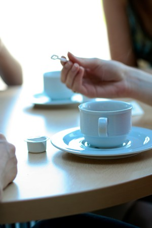 afternoon break: Woman hand and cup of coffee. Coffee break meeting concept