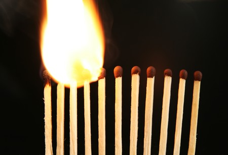 chain reaction: Matches in fire. Fire chain reaction. Strong flame
