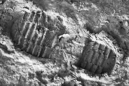 boot print: Track of shoe in mud. Military boot track Stock Photo