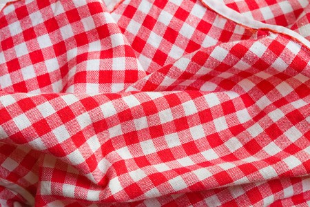 white blanket: Red picnic cloth background. Texture detail closeup