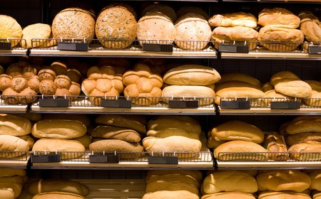 unsliced: Various bread type on shelf. Bakery shop concept Stock Photo