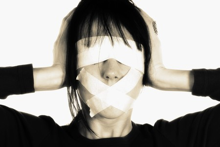 Censor and freedom of speech concept. Media prisoner and human rights concept. Tied mouth and blindfolded eyes. Stock Photo