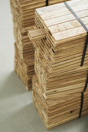 One parquet piece. Wood parquet pieces photo