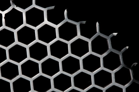 isoalated: Background of metal hexagon grid pattern isoalated on black with missing part